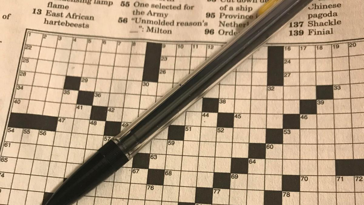 crossword puzzle and pencil - author image