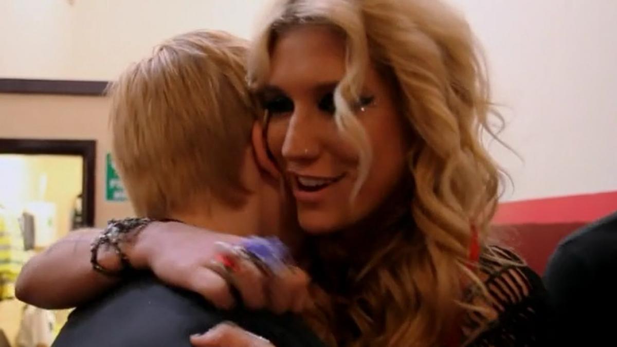 Kesha hugging young man