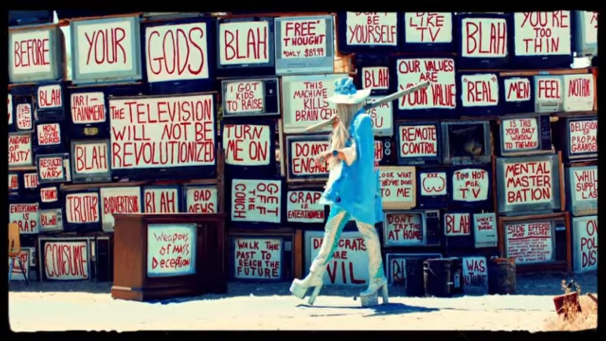 Screenshot of TV Wall from 'Praying' Video""