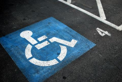 The International Symbol of Access (ISA), also known as the (International) Wheelchair Symbol on pavement - creative commons